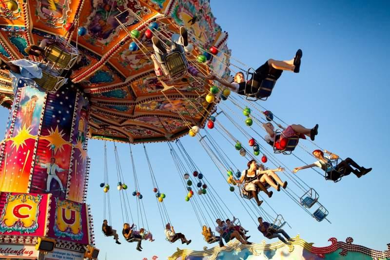 Oktoberfest participants on a carnival ride